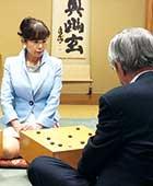 日本棋院特別対局室「幽玄」の間で指導碁をする小川六段